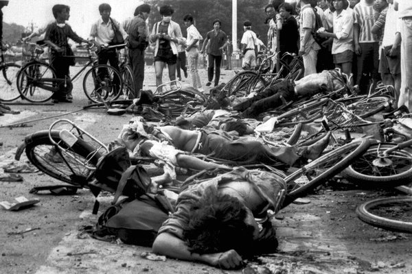 At least four Chinese corpses lie atop twisted bicycles in Tiananmen Square. June 6, 1989.