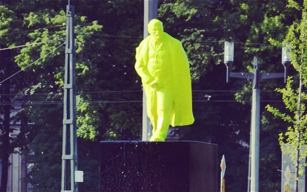 Neon green urinating Lenin statue in Poland.