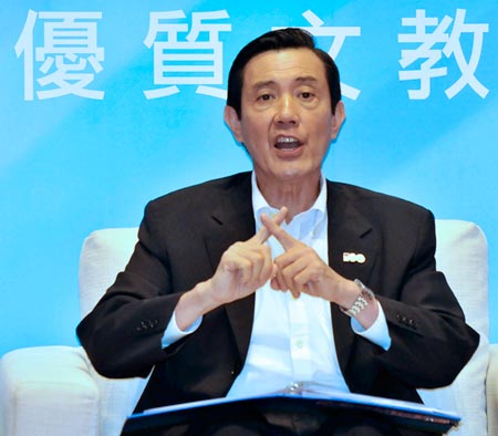 Ma Ying-Jeou with crossed index fingers.
