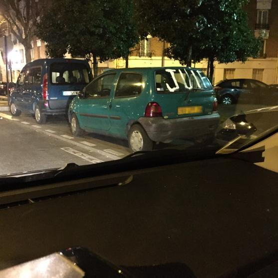 A car with the word, 'Juif' (Jew) spray-painted on the rear window.