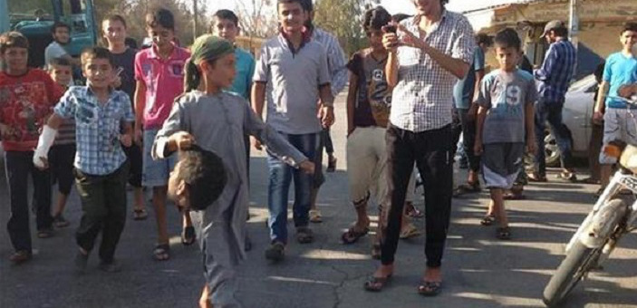Muslim children from ISIS playing with severed head