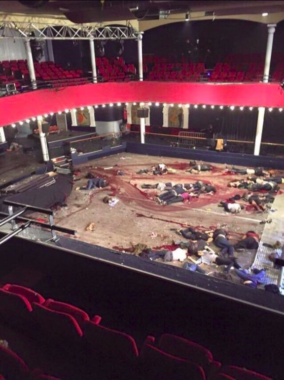 Bloody Muslim death squad victims lying in center of theater.
