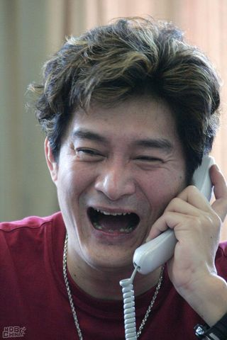 Huang An on telephone