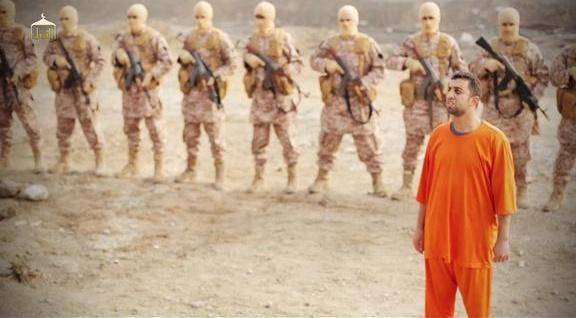 Moaz al-Kasasbeh being led to cage before being doused in gasoline and burned alive by ISIS.