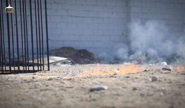 Trail of flame leading to cage holding Moaz al-Kasasbeh before he's burned alive by ISIS.