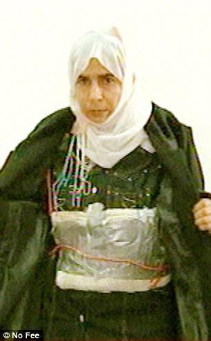 Terrorist Sajida al-Rishawi wearing suicide belt.