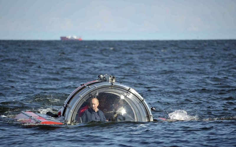 Vladimir Putin on surface of ocean in a submersible