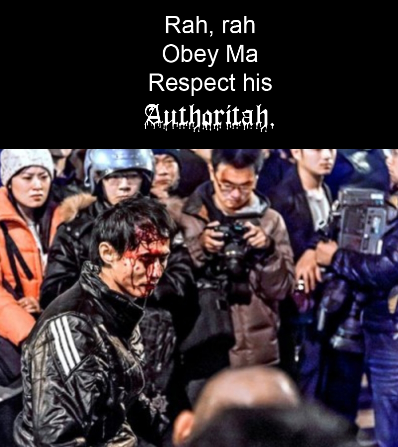Image of man beaten bloody during Sunflower protests against Taiwanese president Ma Ying jeou, with caption: 'Rah rah, Obey Ma, Respect his, Authoritah.'